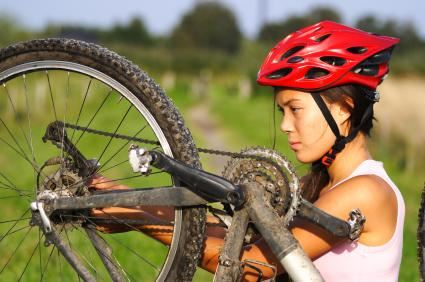 Woman Working on Bike